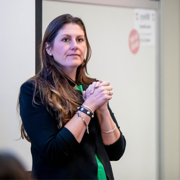 Image displays Kelsey Ramsden teaching in front of a class.
