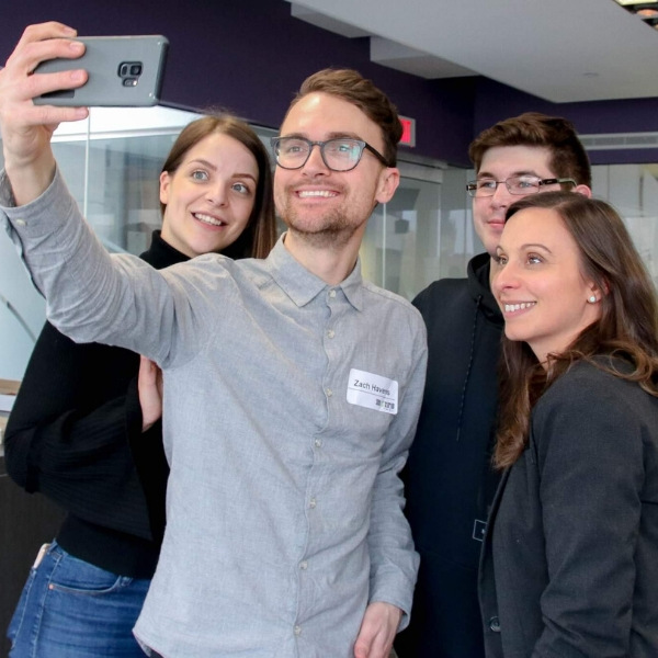 Image of webinar host, Zach Havens, taking a selfie with other entrepreneurs.