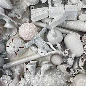 a pile of small objects painted white