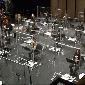 Western University Jazz Ensemble performing on stage behind barriers